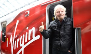 Richard Branson gives the thumbs up on a Virgin train
