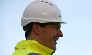 Chancellor of the Exchequer George Osborne chats with employees during a visit to a housing development this morning.