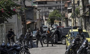 Brazilian police block access to the scene of the shootout during a gang operation in Rio last Friday.
