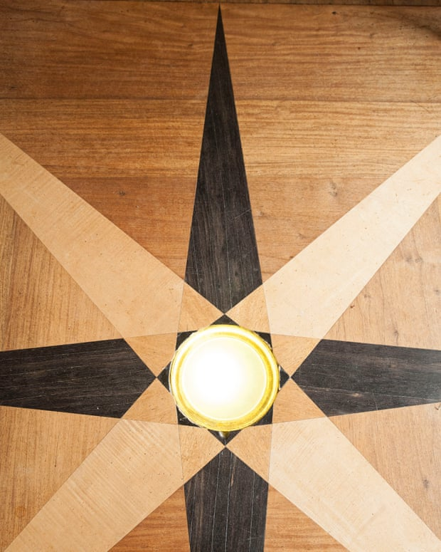 Star quality: inlaid wooden floor in the hall.