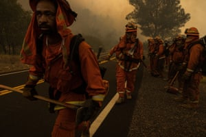 Fire crews move along a freeway as the Moc Fire burns in Moccasin on Thursday.