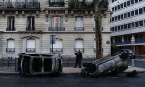 Charred cars after the protests in Paris on Sunday.