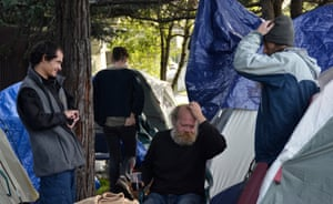 Brett Schnaper, center, and Mike Zint, right, at the First They Came for the Homeless encampment in Berkeley.