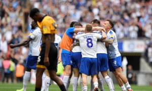 Tranmere players swamp Connor Jennings after his late goal against Newport in the League Two play-off final.