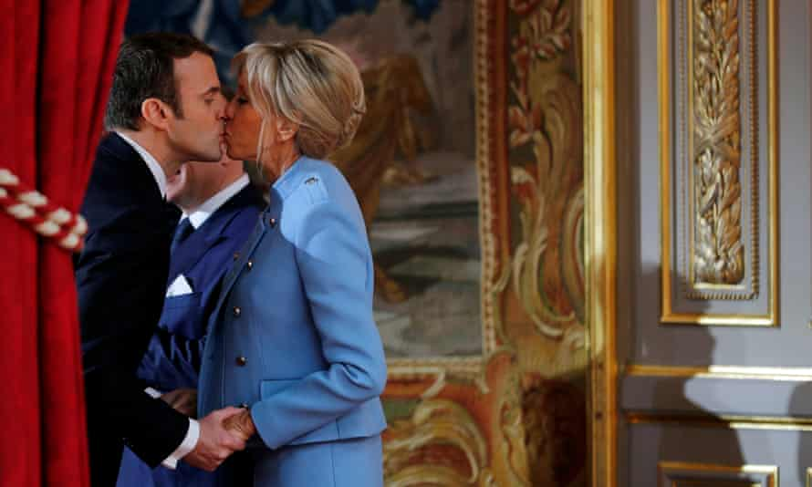 Macron and his wife, Brigitte,  at the handover ceremony in May