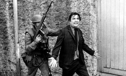 John Hume being detained by a soldier during a civil rights protest in Derry in August 1971.