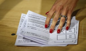 Polling card marked 'Yes' is seen as vote counting begins