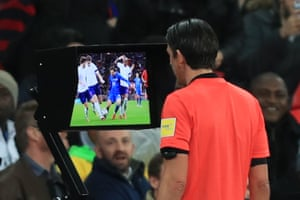 The referee consults VAR before awarding the penalty.