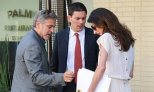 George and Amal Clooney are supporters of the humanitarian agency headed by David Miliband.