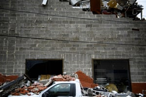 A truck is seen below a partial collapsed wall after Hurricane Michael devastated Panama City, Florida.