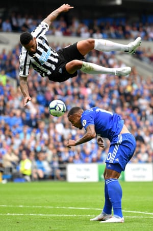 Jamaal Lascelles of Newcastle United challenges for the ball with Kenneth Zohore of Cardiff City during the goalless draw at the Cardiff City Stadium.