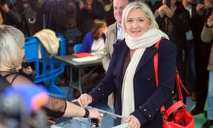 Front National leader Marine Le Pen prepares to vote in the first round of regional elections.