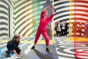 Mikaela Carr and Amber McCartney from Chunky Move perform among a Pae White installation at the NGV Triennial.