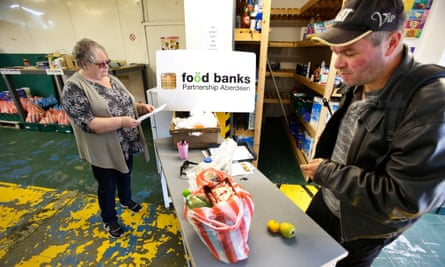 A man visits a food bank in Aberdeen. More than a fifth of the UK's population live in poverty