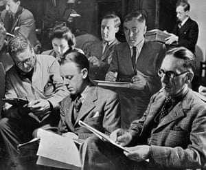 A group of cartoonists at a life drawing class held in the White Swan pub near Fleet Street in 1947. Left to right: Giles of the Express, Rowland Davies, creator of Steve, and Norman Pett who draws Jane for the Daily Mirror. Behind them is Illingworth of the Daily Mail