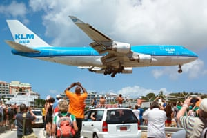 A 747 jumbo lands in St Maarten, in the Caribbean.