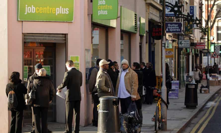 People queue outside a branch of Job Centre Plus