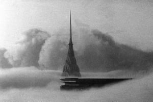 The top of the Chrysler Building and the roof of the Pan Am building, foreground, in Manhattan are seen above the fog on 13 February 1984