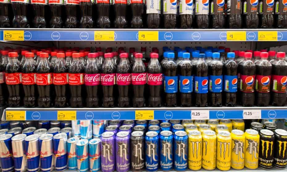 Fizzy drinks on a supermarket shelf.