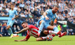 Adam Armstrong is brought down by Kyle Walker.