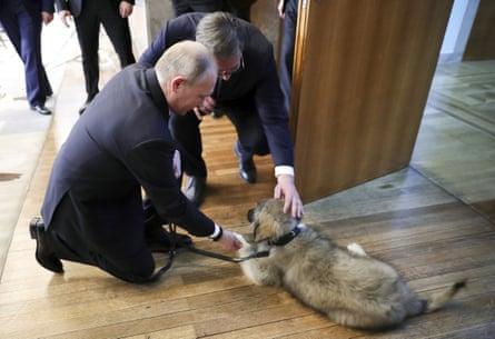 Aleksandar Vučic presents Vladimir Putin with a puppy in Belgrade on Thursday.