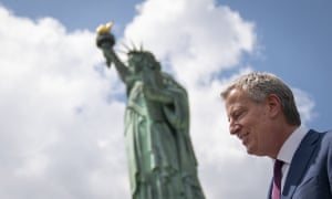 Mayor Bill de Blasio departs Liberty Island following a dedication ceremony for the new Statue of Liberty Museum on Thursday.