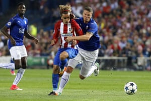 Leicester's Robert Huth, right, tussles with Antoine Griezmann.