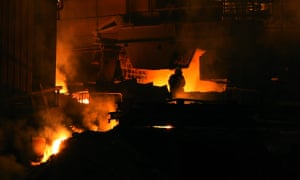 A lone worker is seen inside a steelworks plant at Redcar