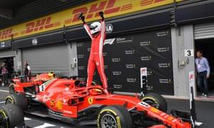 Sebastian Vettel celebrates his victory for Ferrari in the Belgian F1 Grand Prix.