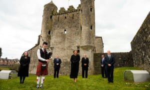 Arlene Foster, along with Deborah Erskime, Piper Aaron Elliott, Keith Elliott, Cllr Errol Thompson, Cllr Mark Buchanan and Cllr Paul Robinson, observe a minute's silence at Enniskillen Castle, Co Fermanagh.
