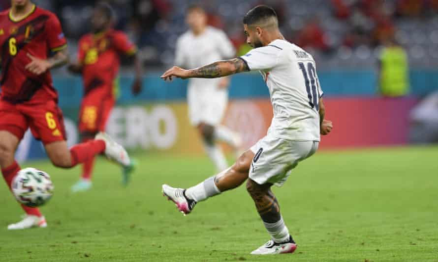 Lorenzo Insigne scores Italy's second goal against Belgium.