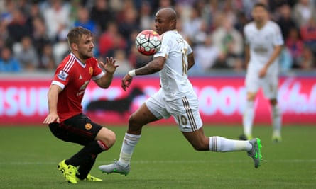 Luke Shaw, left, found his displays of initiative to be costly as André Ayew and Swansea exploited the space behind him.