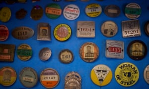 COATESVILLE, PA - June 6, 2018: Assorted steelworkers pins are seen in the National Iron and Steel Heritage Museum beside The Lukens Steel Mill in Coatesville, Pennsylvania, the oldest steel mill in commission within the United States, on June 6, 2018. CREDIT: Mark Makela for The Guardian