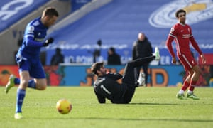 Liverpool's Alisson Becker clashes with his own player Ozan Kabak leading to Leicester City's Jamie Vardy scoring his side's second goal .