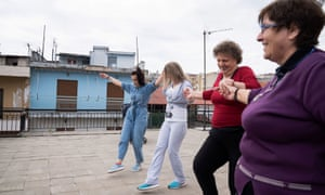 People dance on a rooftop terrace as they celebrate Easter Sunday, during a nationwide lockdown to prevent the spread of the coronavirus outbreak in Ioannina, Greece, April 19, 2020. REUTERS/Dimitris Rapakousis