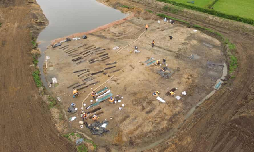 Aerial view of plank-lined graves and coffins made from hollowed tree trunks in Norfolk