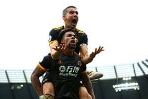 Conor Coady launches himself onto the back of Adama Traore to celebrate his first of two for Wolves to beat City 2-0.