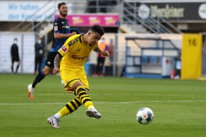 Sancho scores his team's sixth goal past Paderborn's German goalkeeper Leopold Zingerle.