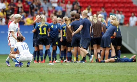 Megan Rapinoe consoles Carli Lloyd after defeat to Sweden in the Olympic quarter-final.