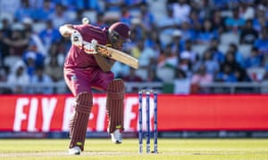 Oshane Thomas of West Indies gloves the ball to Rohit Sharma of India to lose his wicket off the bowling of India's Mohammed Shami.