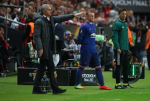 Manchester United's Wayne Rooney prepares to come on as a substitute as Manchester United manager Jose Mourinho gestures.