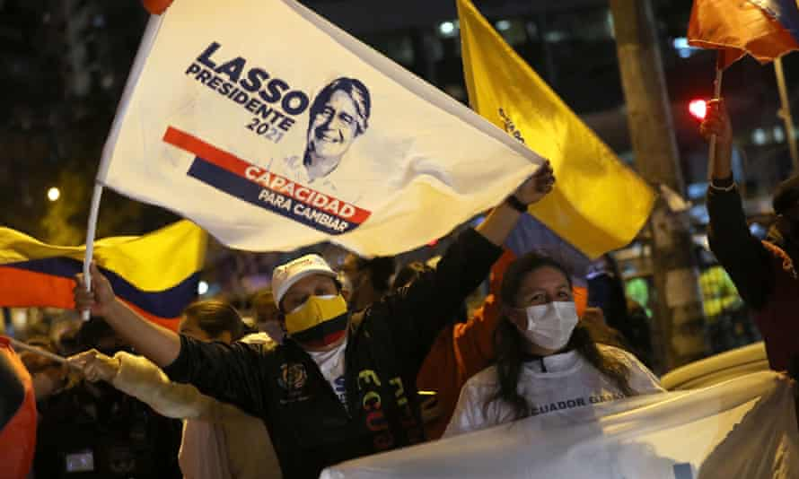 Supporters of ecuador presidential candidate Guillermo Lasso wave flags