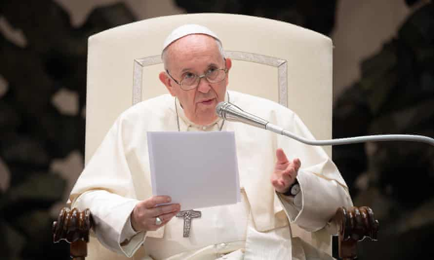 Pope Francis in chair with microphone