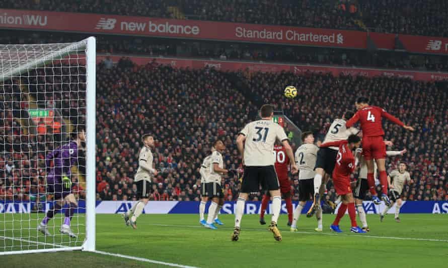Virgil van Dijk heads home Liverpool's first goal from a corner.
