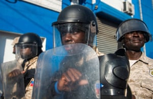 Police patrol the streets during a march to demand the resignation of the president, Jovenel Moïse in Port-au-Prince, Haiti