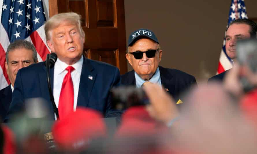 Trump and Giuliani at the president's golf club in New Jersey in August. Presidential pardons are a common feature of the waning days of any White House term.