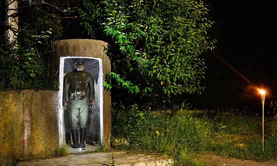 A lifelike model of a guard outside the bunker.