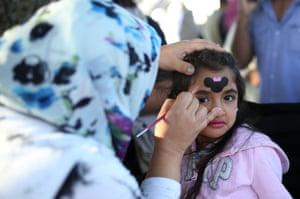 Girl receiving face paint