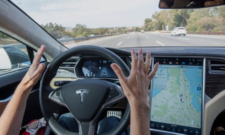 A Tesla driving along a California freeway with its autopilot engaged.