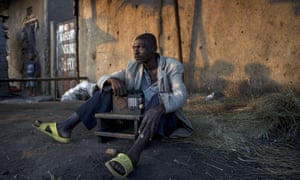 A man listens to the news on the radio in Bujumbura, following the contested presidential election